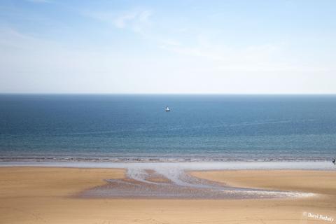 A Boat At Three Cliffs Bay